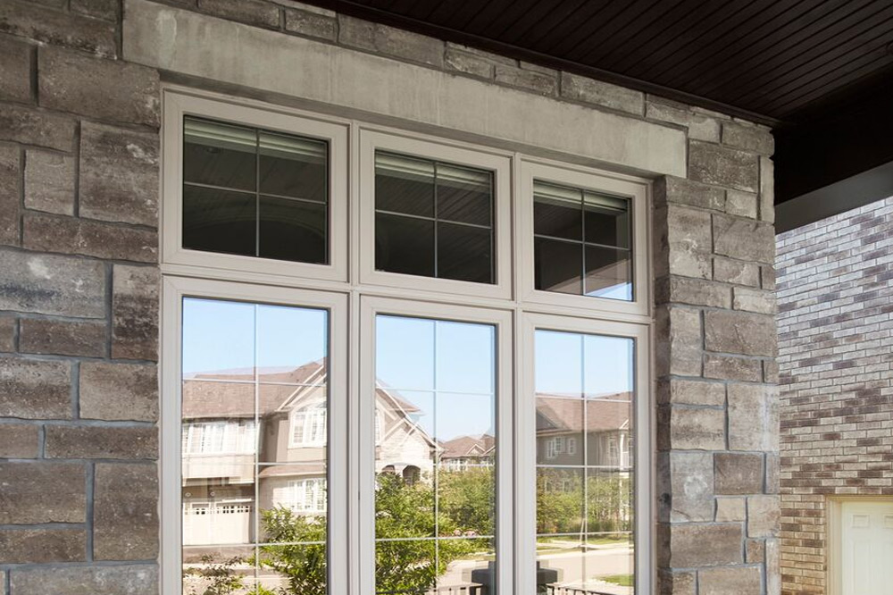 Awning windows installed on stone wall house