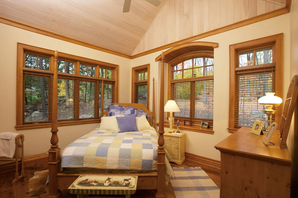 Wood casement windows in bedroom