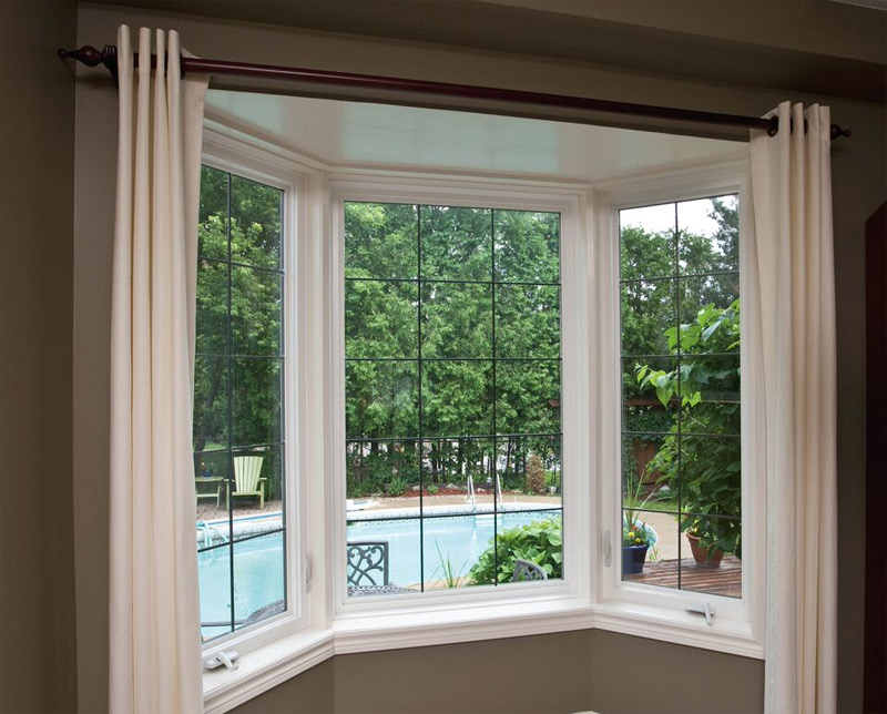 Installation photo of bay window that was replace in living room & Replacement - Residential | Pollard Windows \u0026 Doors