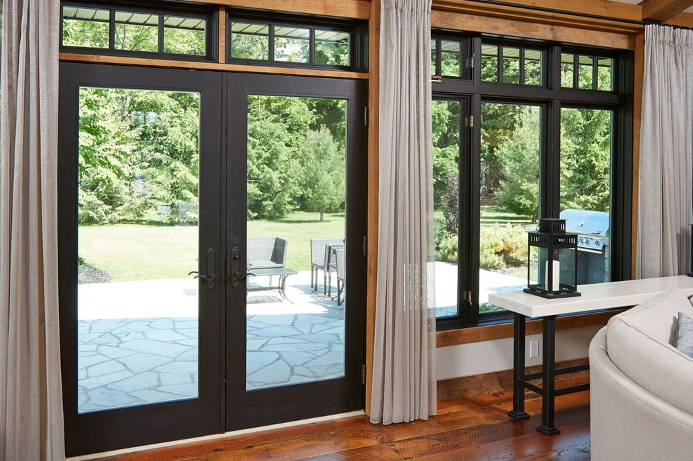 Black french doors leading to backyard